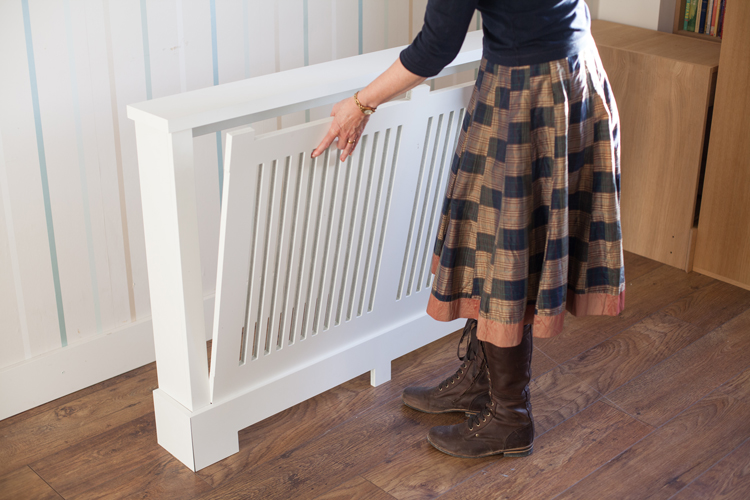 Jali bespoke radiator cabinet showing grille being inserted